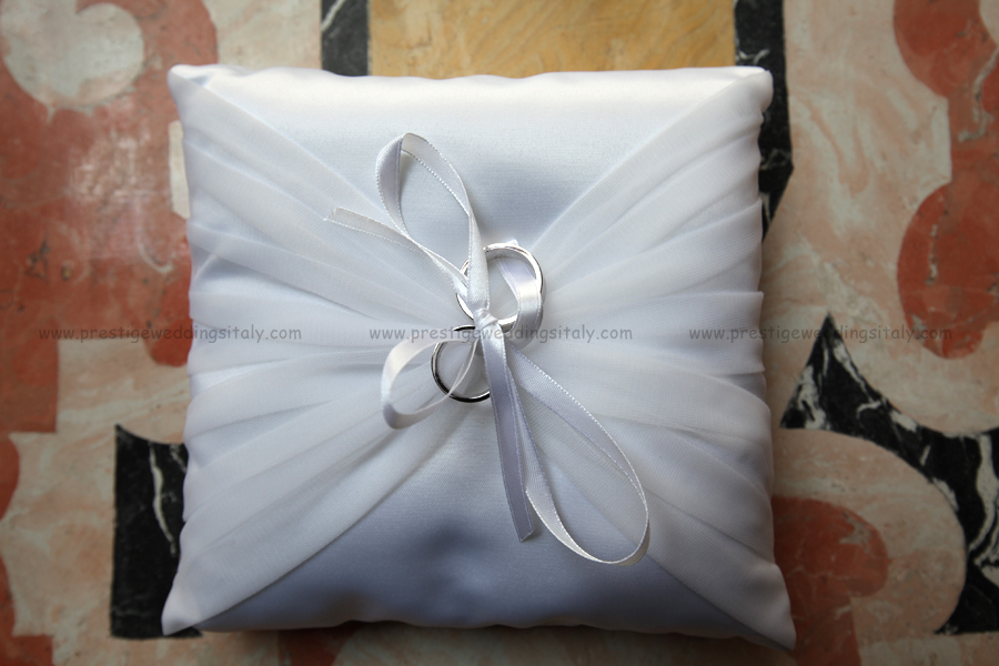 weddings rings on white pillow